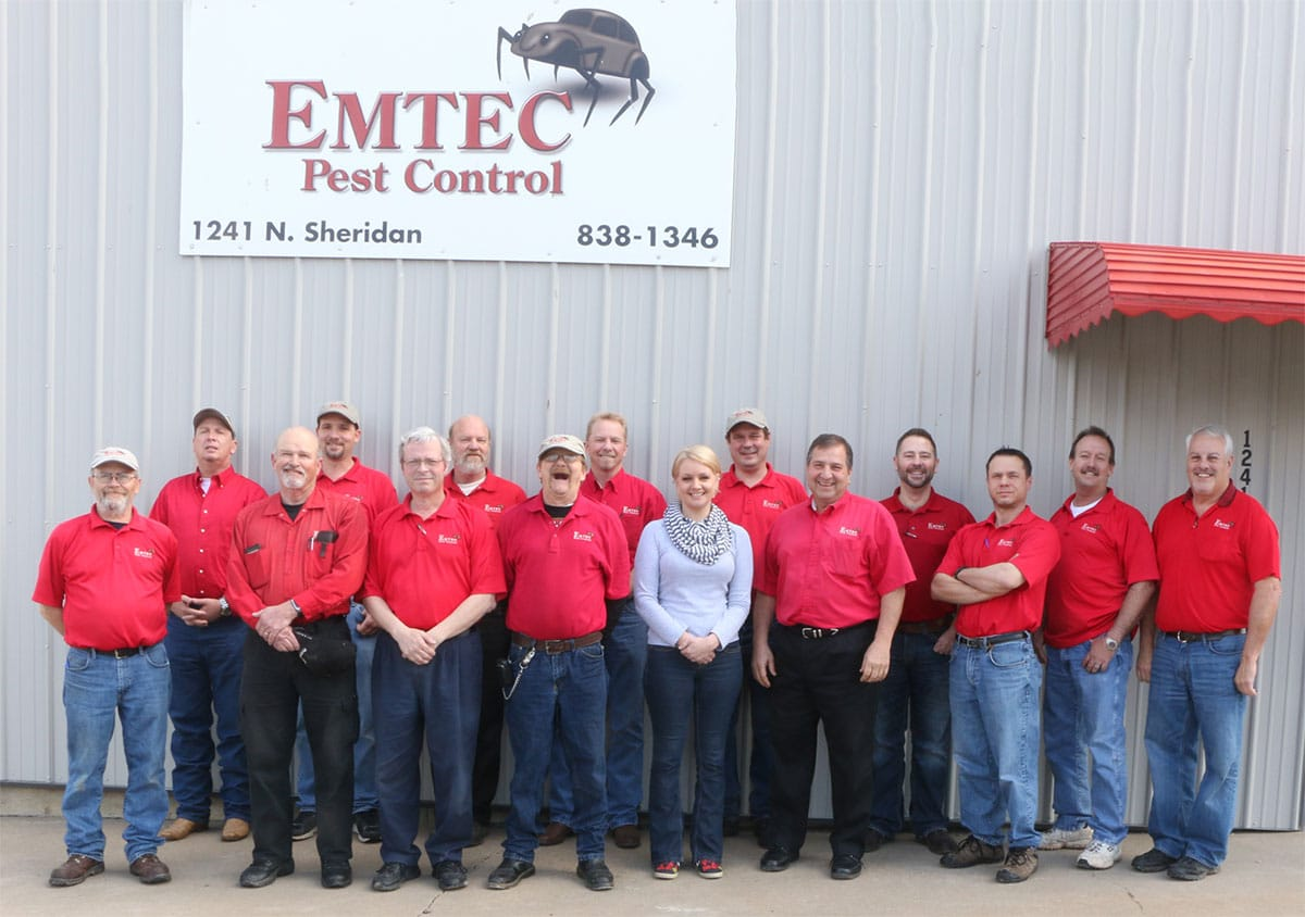 Emtec staff outside building
