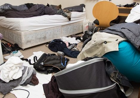 bedroom filthy and dirty. room full of mess with clothes on floor