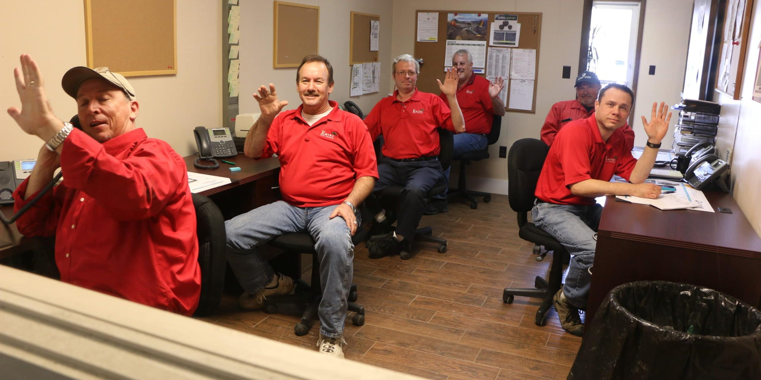 Emtec staff taking calls in the office