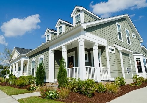 Home with white trim and manicured lawn