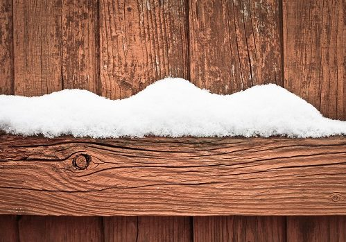 Snow on fence